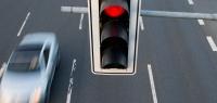 Новую систему штрафов за проезд на красный предложили в России